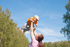 Mother playing with baby in the sky Stock Photo