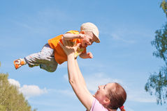 Mother playing with baby in the sky Royalty Free Stock Photography