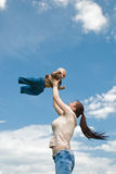 Mother playing with baby in the sky Royalty Free Stock Photo