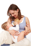 Mother playing with breastfeeding. Young Mother and pretty child Royalty Free Stock Image