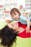 Mother playing with child Stock Photography