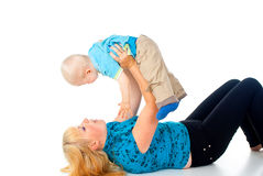 Mother playing with child holding hands Stock Images