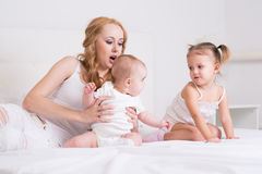 Mother playing with children Royalty Free Stock Photos