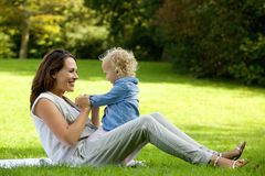 Mother playing with cute baby outdoors Royalty Free Stock Photography