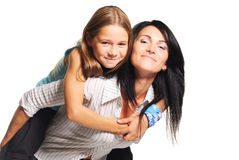 Mother playing with daughter. On white background Royalty Free Stock Photography