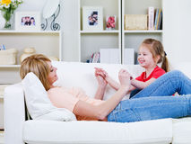 Mother playing with daughter Royalty Free Stock Photos