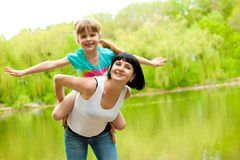 Mother playing with daughter royalty free stock photo