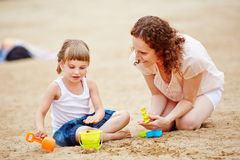 Mother playing with daughter at beach Royalty Free Stock Images