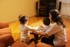 Mother playing with daughters at home Royalty Free Stock Image