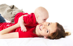 Mother playing with her baby. Young mother playing with her baby boy stock photography