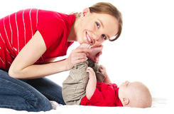 Mother playing with her baby. Young mother playing with her baby boy stock image