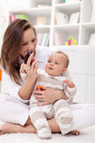 Mother playing with her baby girl Royalty Free Stock Photos