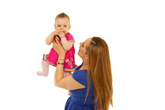 Mother playing with her baby girl Stock Photography