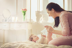 Mother playing with her baby Royalty Free Stock Images
