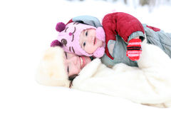 Mother playing with her baby in winter park stock photos