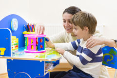 Mother playing with her child. Some creativity game Royalty Free Stock Image