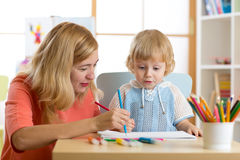 Mother playing with her child son, drawing together. Mother playing with her little son, drawing together Royalty Free Stock Photos