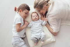 Mother playing with her 2 children stock photography
