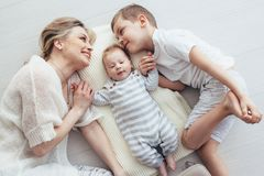 Mother playing with her 2 children royalty free stock photo