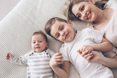 Mother playing with her 2 children stock photo