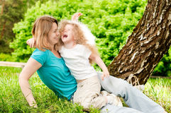 Mother playing with her daughter Stock Photos