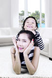 Mother playing with her daughter at home Stock Photography