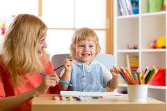 Mother playing with her kid son, drawing together. Mother playing with her little son, drawing together Royalty Free Stock Photos