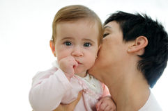 Mother playing with her little daughter. A mother playing with her little baby on white background Stock Photo