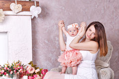 Mother playing with her little daughter. Royalty Free Stock Photography