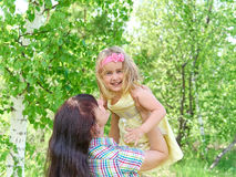 Mother playing with her  little daughter on nature Royalty Free Stock Photo