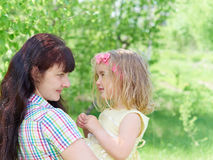 Mother playing with her  little daughter on nature Royalty Free Stock Photos