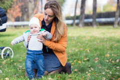 A mother playing with her little son in park Stock Image