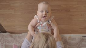 Mother playing with her newborn daughter stock video footage