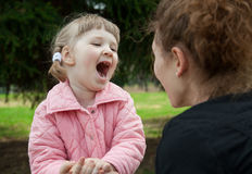 Mother playing with her smiling little daughter Royalty Free Stock Images
