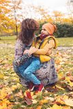 Mother playing with her son in the autumn park. Mum and son together royalty free stock image