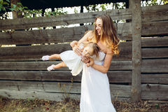 Mother playing with his little daughter Royalty Free Stock Photos