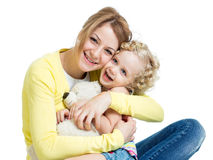 Mother playing with kid girl and plush toy Stock Photos