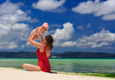Mother playing with little daughter on the beach Royalty Free Stock Photography