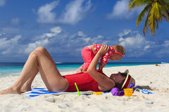 Mother playing with little daughter on the beach Royalty Free Stock Images