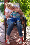 Mother playing peek a boo with her baby boy Stock Images