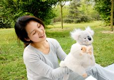 Mother playing plush toys with son Royalty Free Stock Images