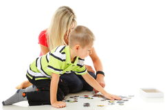Mother playing puzzle together with her son Royalty Free Stock Image