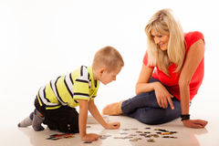 Mother playing puzzle toy with her son Royalty Free Stock Photos