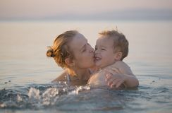 Mother playing in the sea with her little son Royalty Free Stock Photo