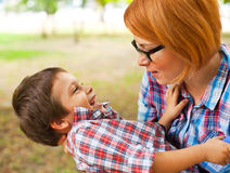 Mother playing with son Stock Image