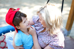 Mother playing with son in park Royalty Free Stock Images