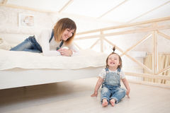 Mother playing wiht her little daughter Royalty Free Stock Photos