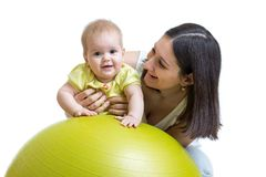 Mother plays with baby on fit ball Stock Photography