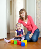 Mother plays with baby  in home Stock Photography