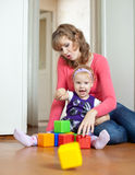 Mother plays with baby  in home Royalty Free Stock Images